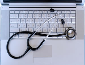 Stethoscope draping over a (Mac) laptop - DoctorGeek logo