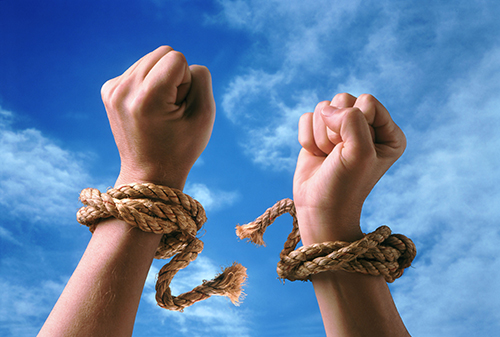 hands with wrists breaking ropes that bound them - symbolizing the freedom on learning how to DIY